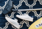 vacuum and white pair of shoes