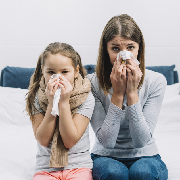 mother daughter suffering from allergy