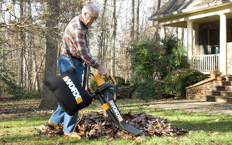 old man using leaf vacuum