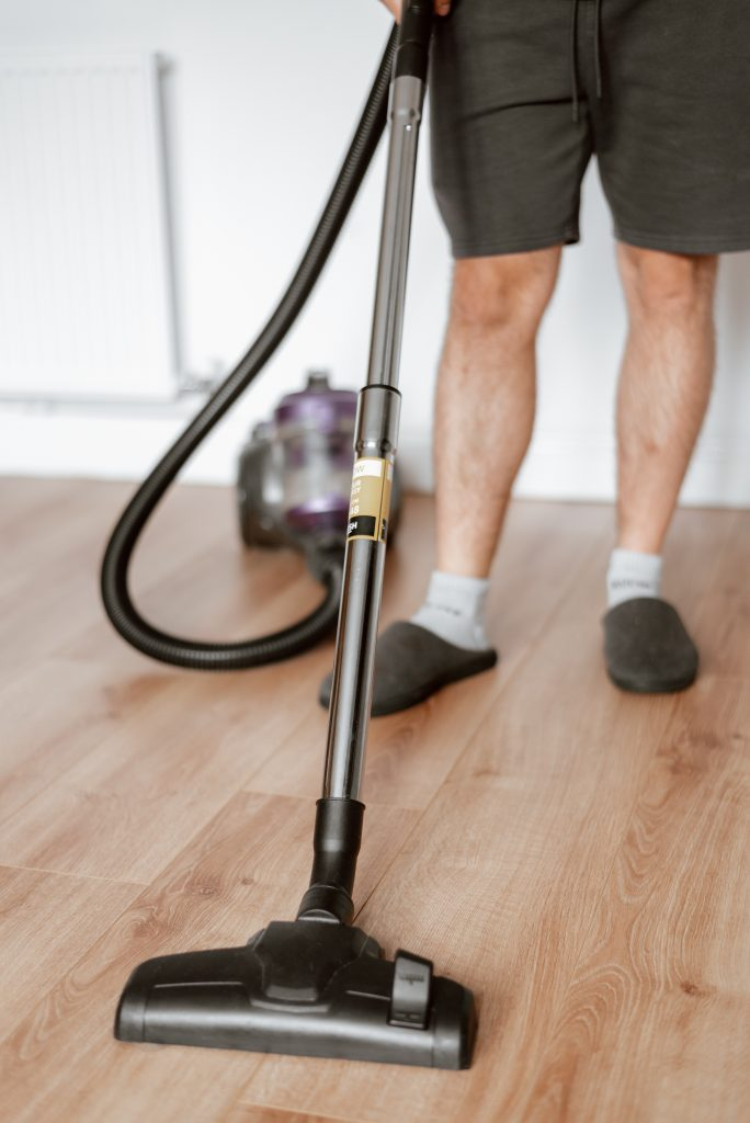 Man in Slippers with Vacuum