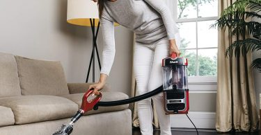 woman cleaning using vacuum